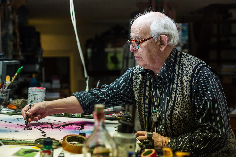 A portrait of Ralph Steadman by Rikard Osterlund, drawing in his studio in Kent